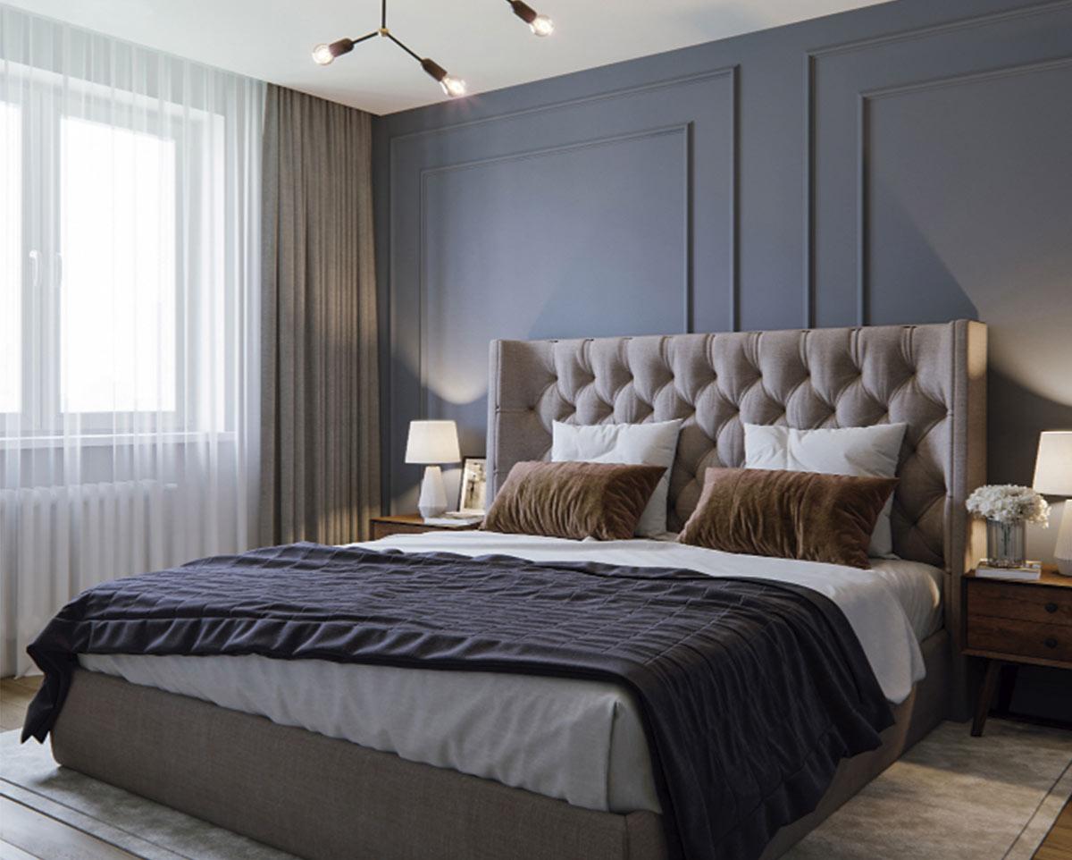 Dormitorio de estilo clásico renovado con revestimiento de pared en madera en tonos grises y protagonismo de los textiles.
